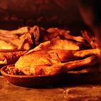 Asado en horno de leña tradicional del cordero lechal